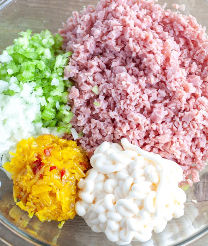 diced ham, diced celery, onion, chow chow and mayonnaise in a bowl