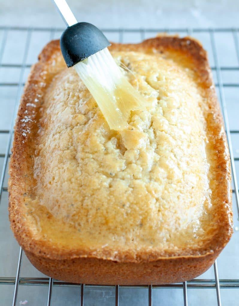 Glazed being brushed on cake