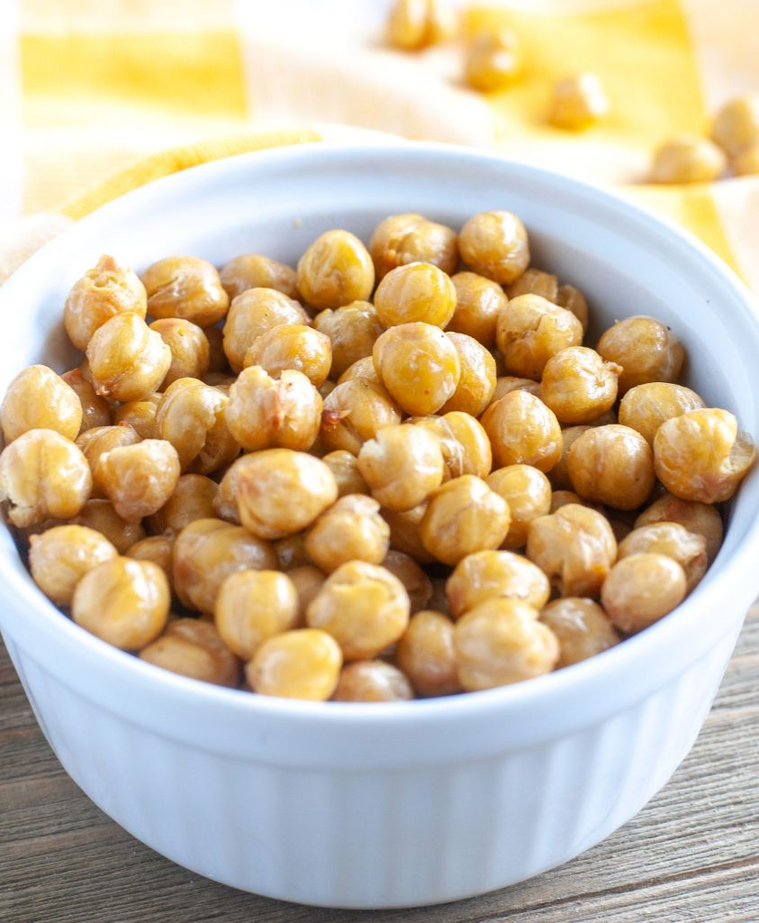 roasted chickpeas in a white bowl with yellow towel