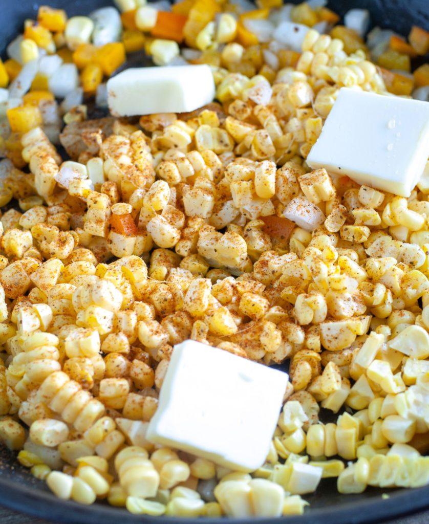 Corn with butter and Cajun seasoning in a skillet