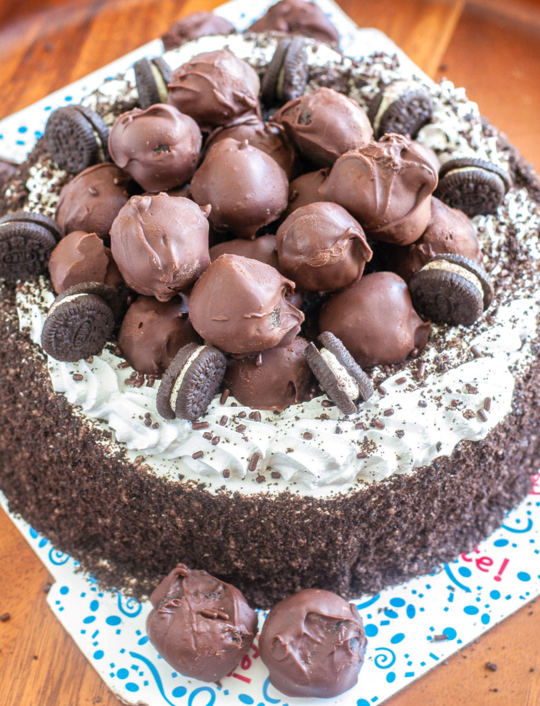 Ice Cream Cake topped with mini OREOS and OREO truffles