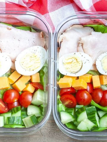 Container with hard boiled eggs, turkey and vegetables.
