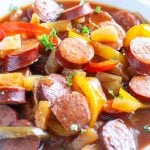 Bowl with sausages and peppers.