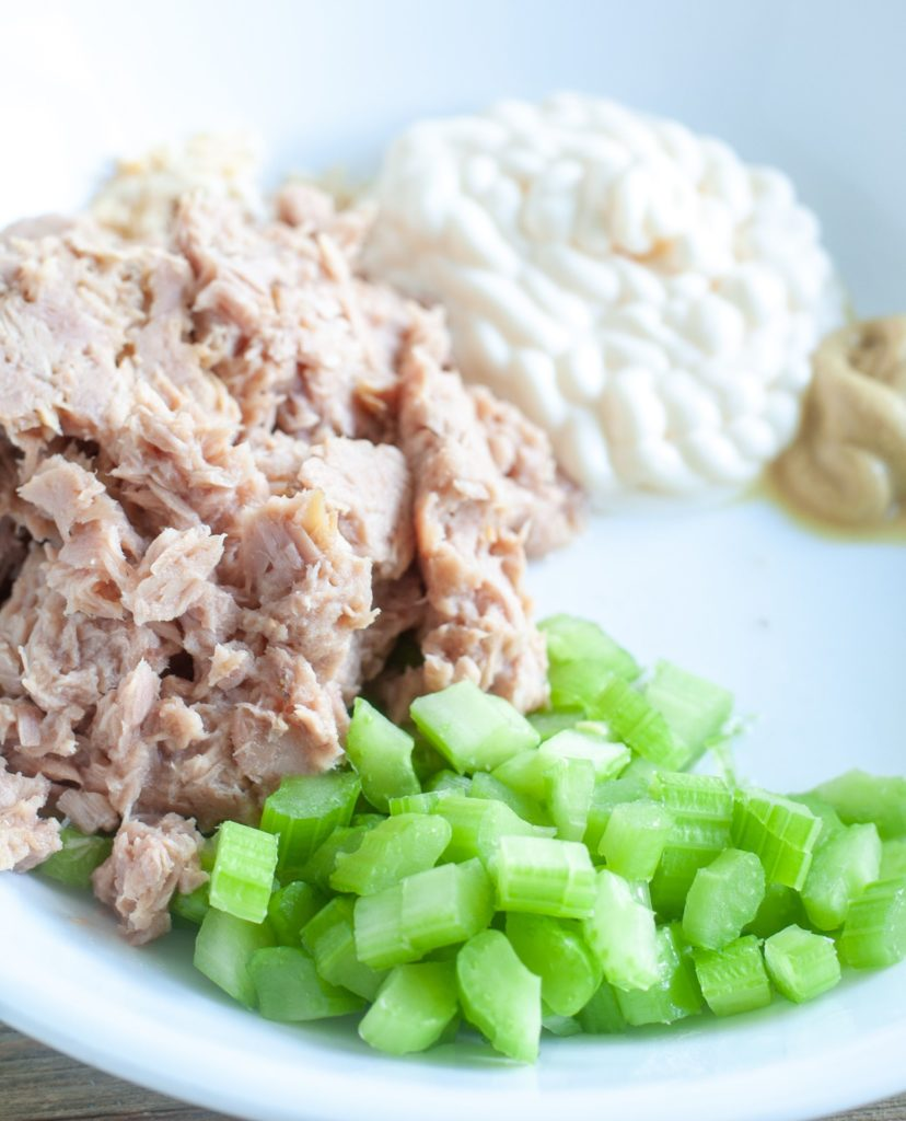 Tuna, mayonnaise, celery and mustard in a bowl.