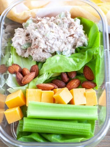 Container with tuna salad, celery and cheese.