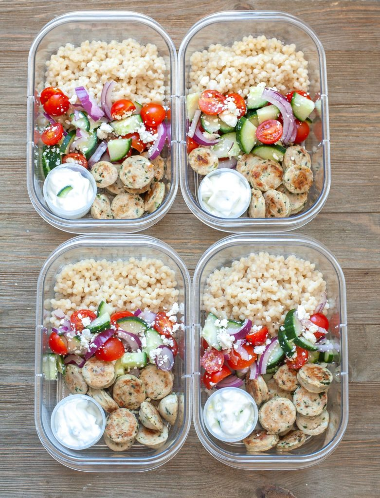 Four Greek Meal Prep Bowls on a table