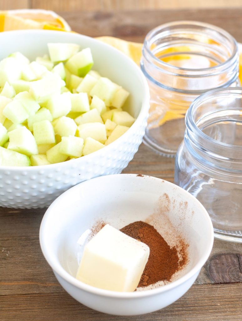 Diced apples, butter, spices and empty jars