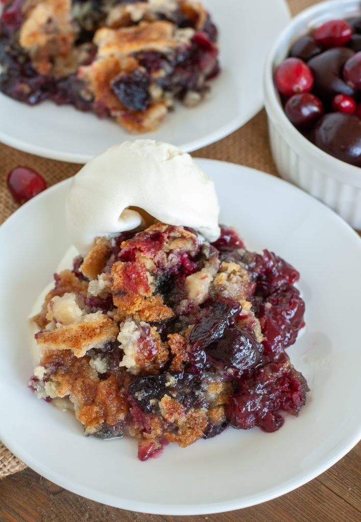 Plate with cranberry cherry dump cake