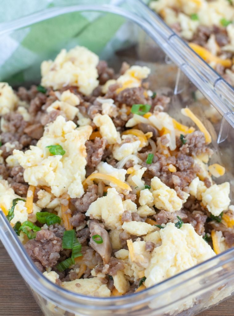 Container with sausage, scrambled eggs and cheese.