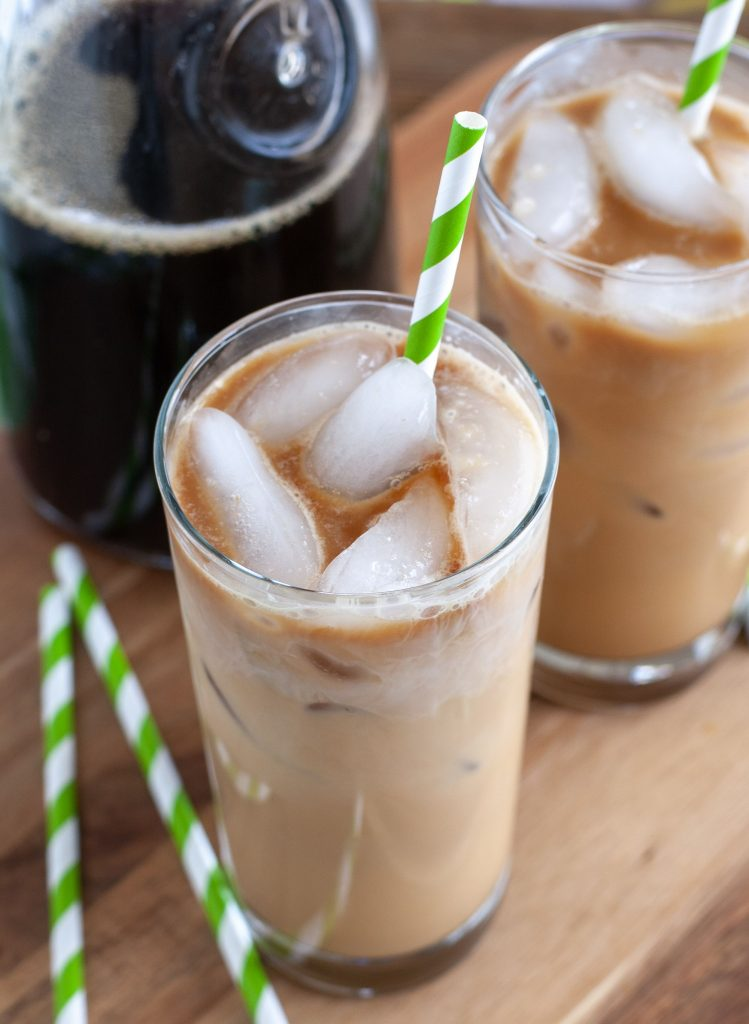two iced lattes with green and white straw