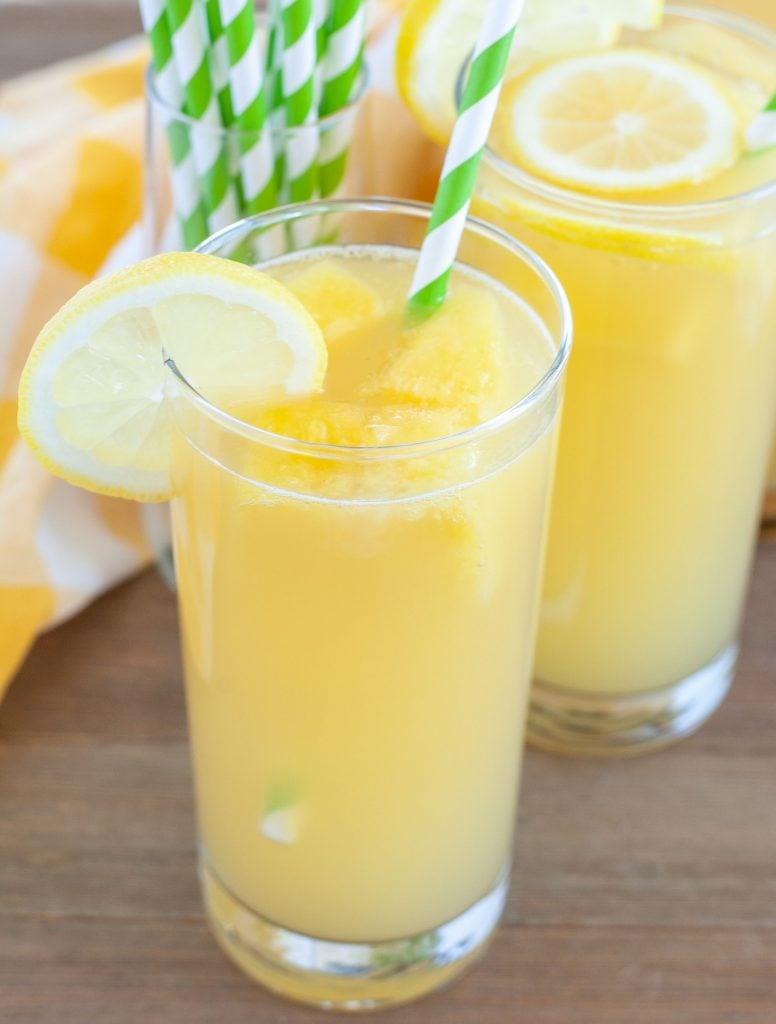 2 glasses of pineapple lemonade with green straws