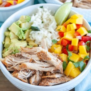 Bowl with shredded carnitas, mango salsa, rice and avocado