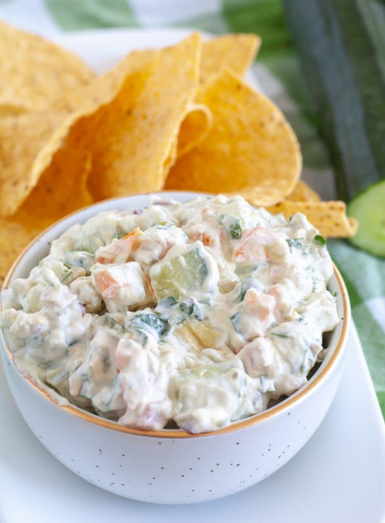 cucumber dip in bowl with chips