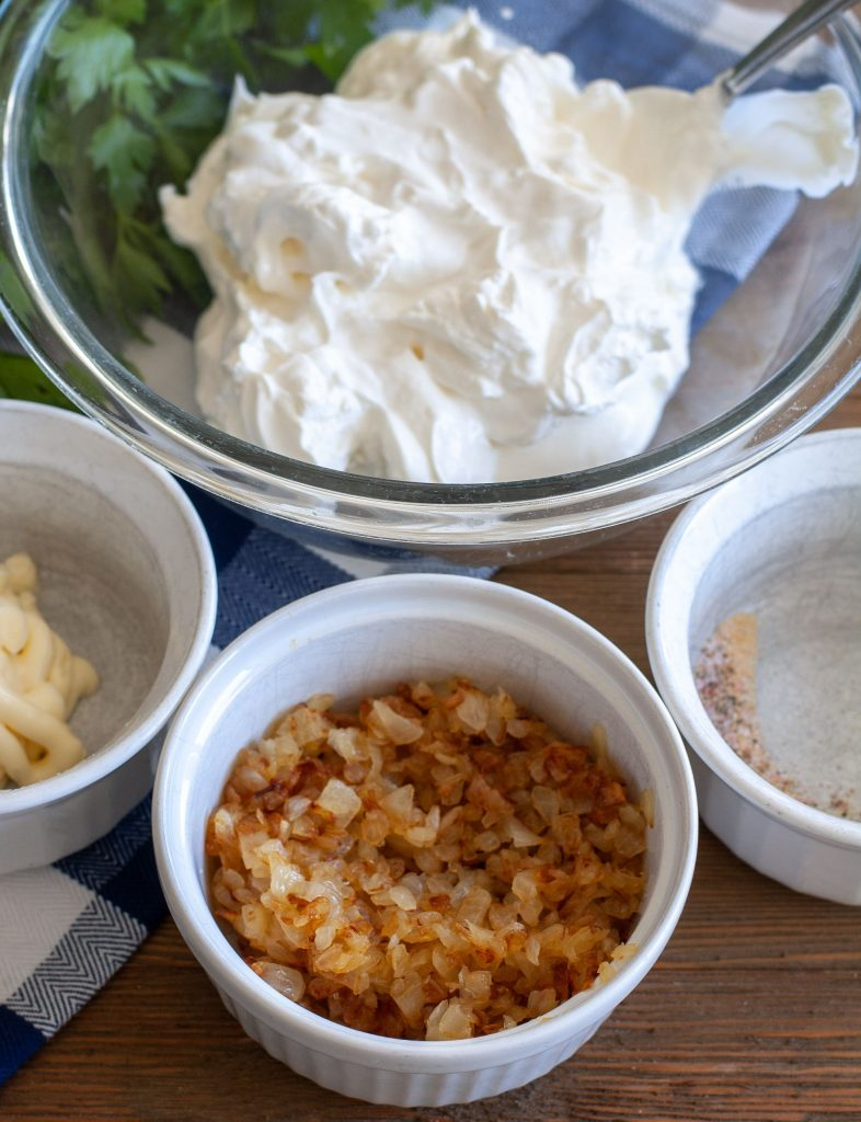 Bowl of sour cream, mayo, onions and spices