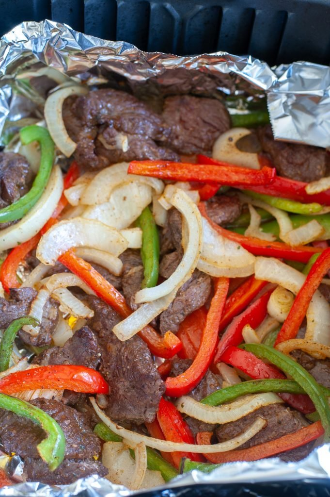 Steak, peppers and onions  in foil