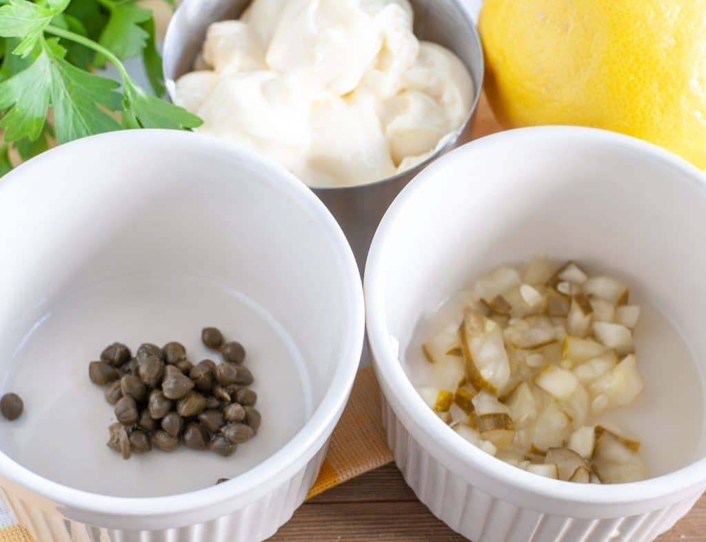 Capers, pickles, lemon, mayonnaise and parsley