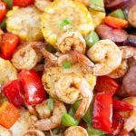 Shrimp and peppers in bowl.