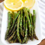 Asparagus on a plate with lemons