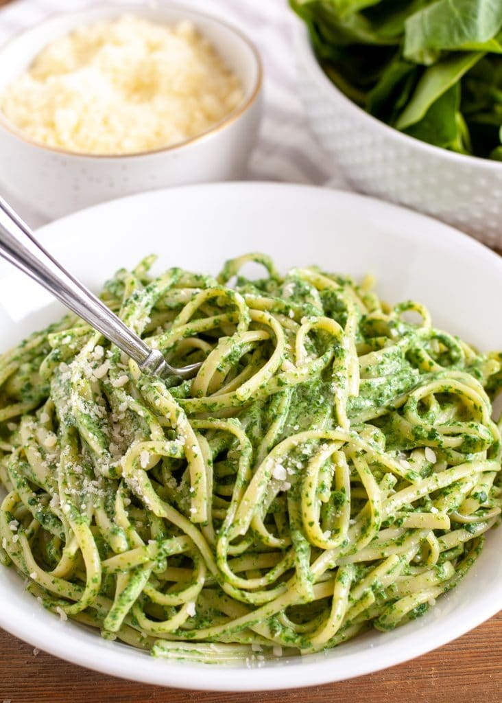Green Pasta Sauce in a bowl and fork