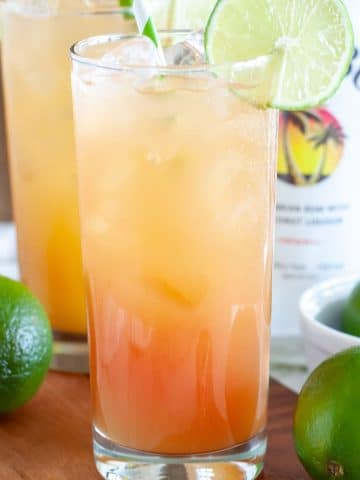 Glass with Malibu and lime slice.