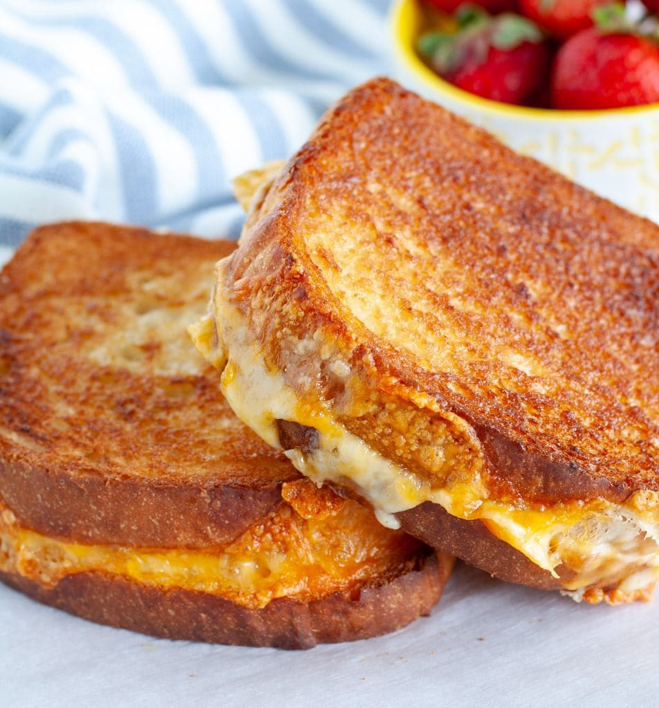 2 grilled cheese sandwiches on a plate