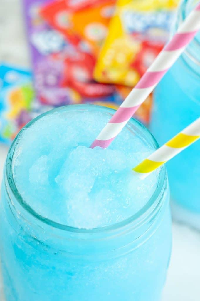 Blue slushie in a glass.