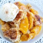 Peach cobbler with scoop of ice cream.