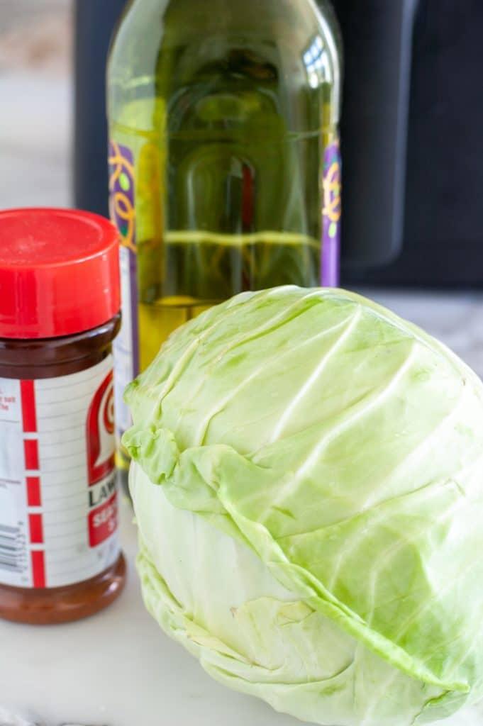 Head of cabbage, oil and seasoned salt