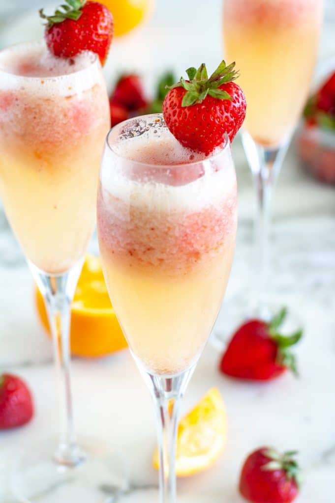 Glass of mimosa with a strawberry on top