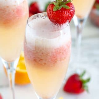 mimosa in glass with strawberry
