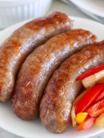 Plate of sausages and peppers.