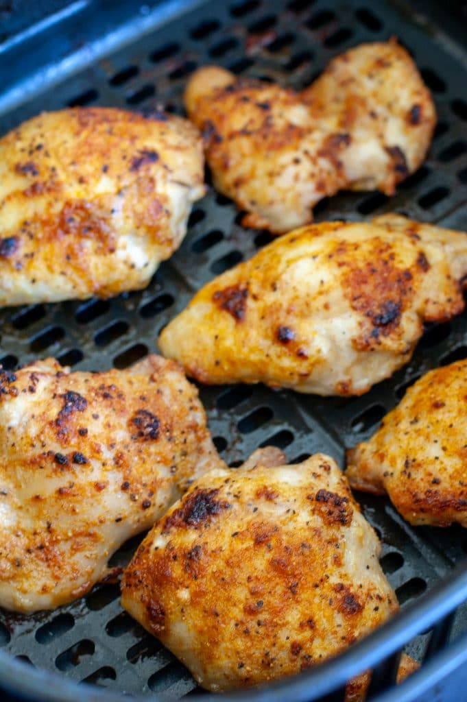 cooked chicken thighs in air fryer basket