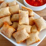 Pizza rolls on plate with sauce