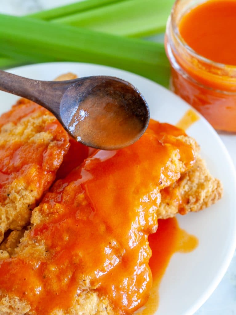Spoon with buffalo sauce with chicken