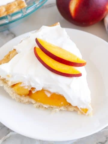 peach cream pie on a plate