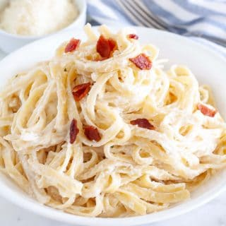 Pasta with cream sauce on a plate