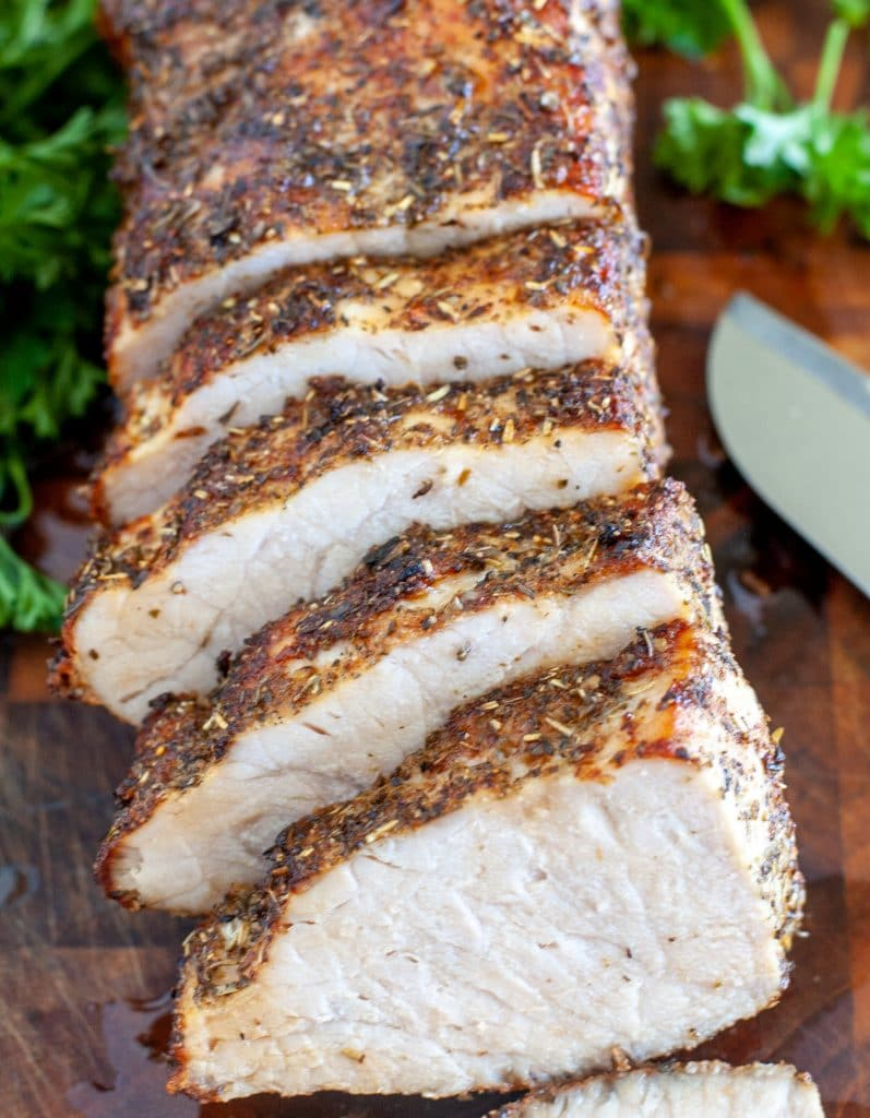 Sliced pork on a board with knife