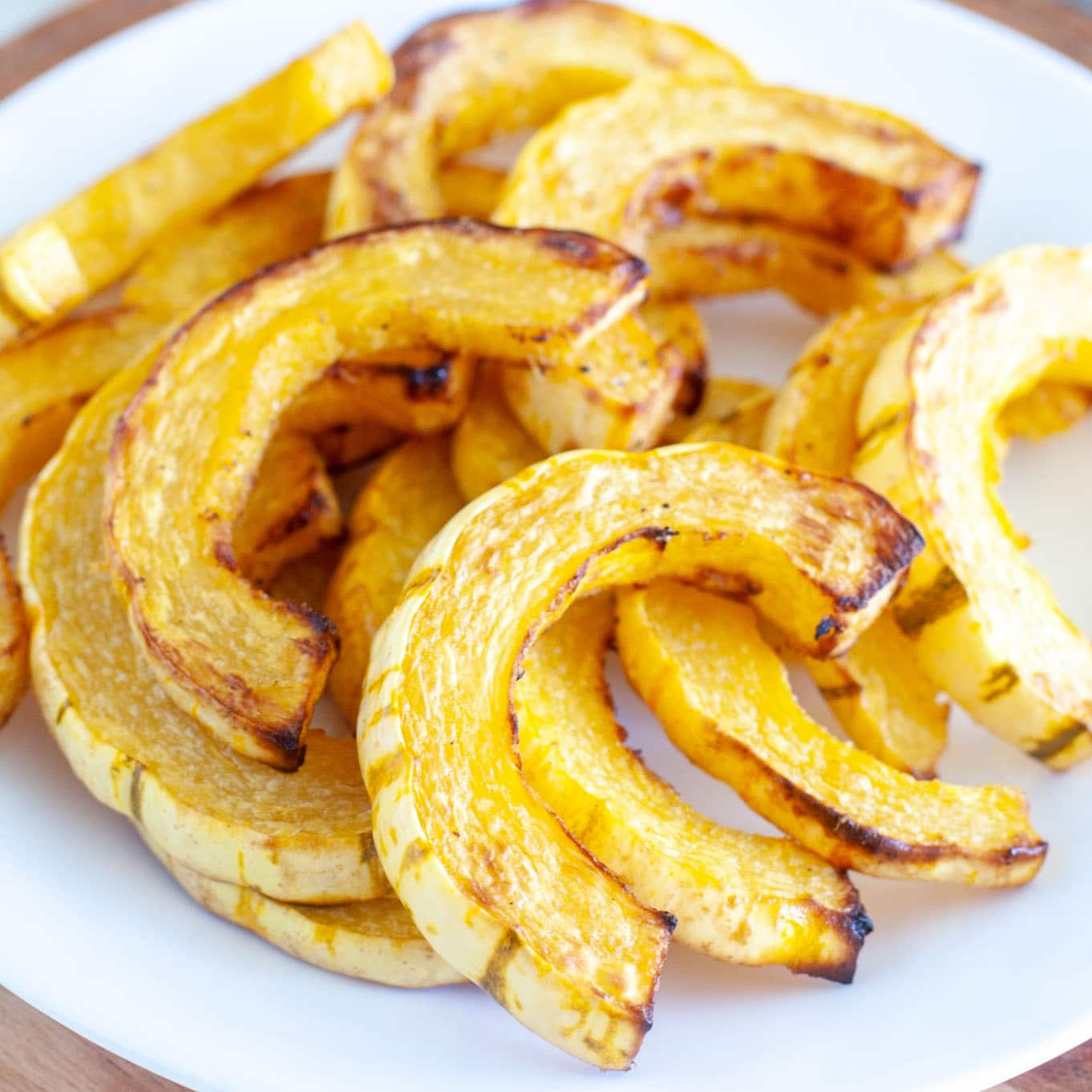 Sliced roasted squash on plate.