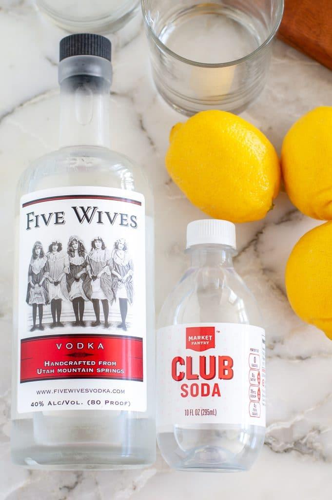 Bottle of vodka, club soda and lemons