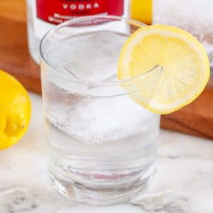 Glass with water and lemon slice.