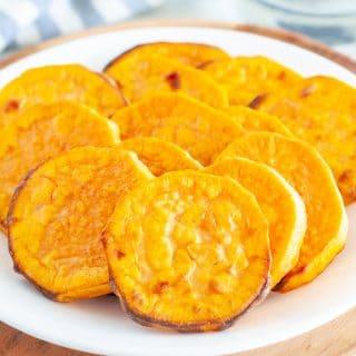 Roasted sweet potato slices on plate