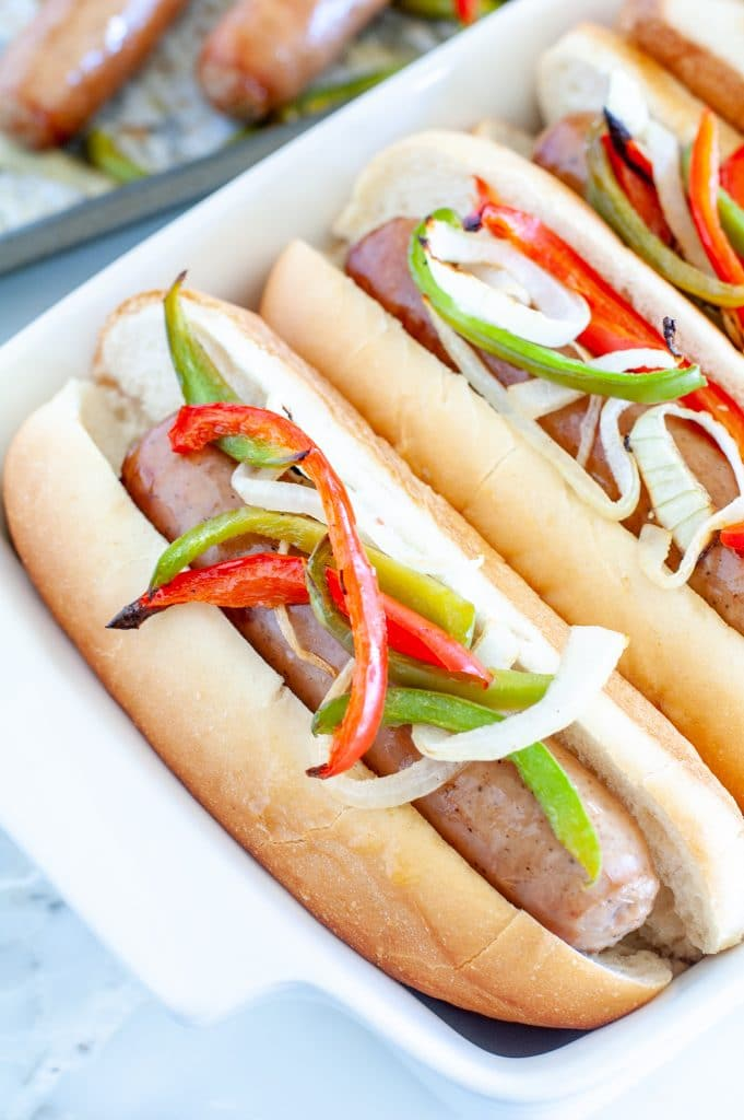 Sausage in roll with peppers and onions