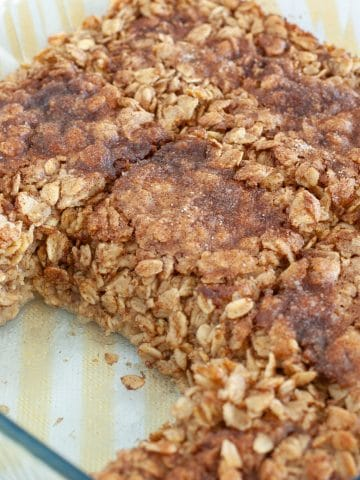 Oatmeal in baking dish with piece missing.