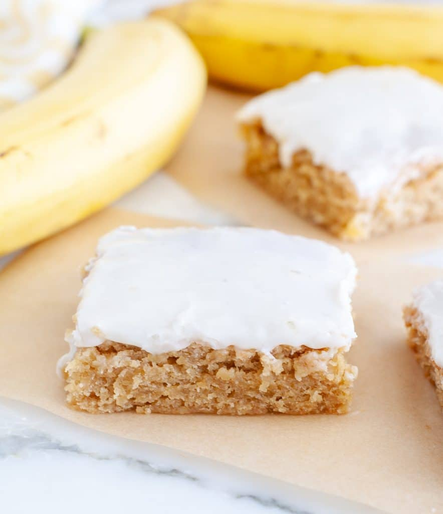 Piece of cake with vanilla frosting and banana.