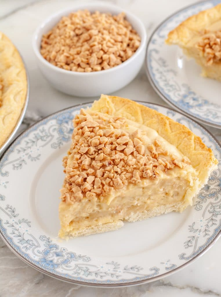 Slice of butterscotch pie on a plate.