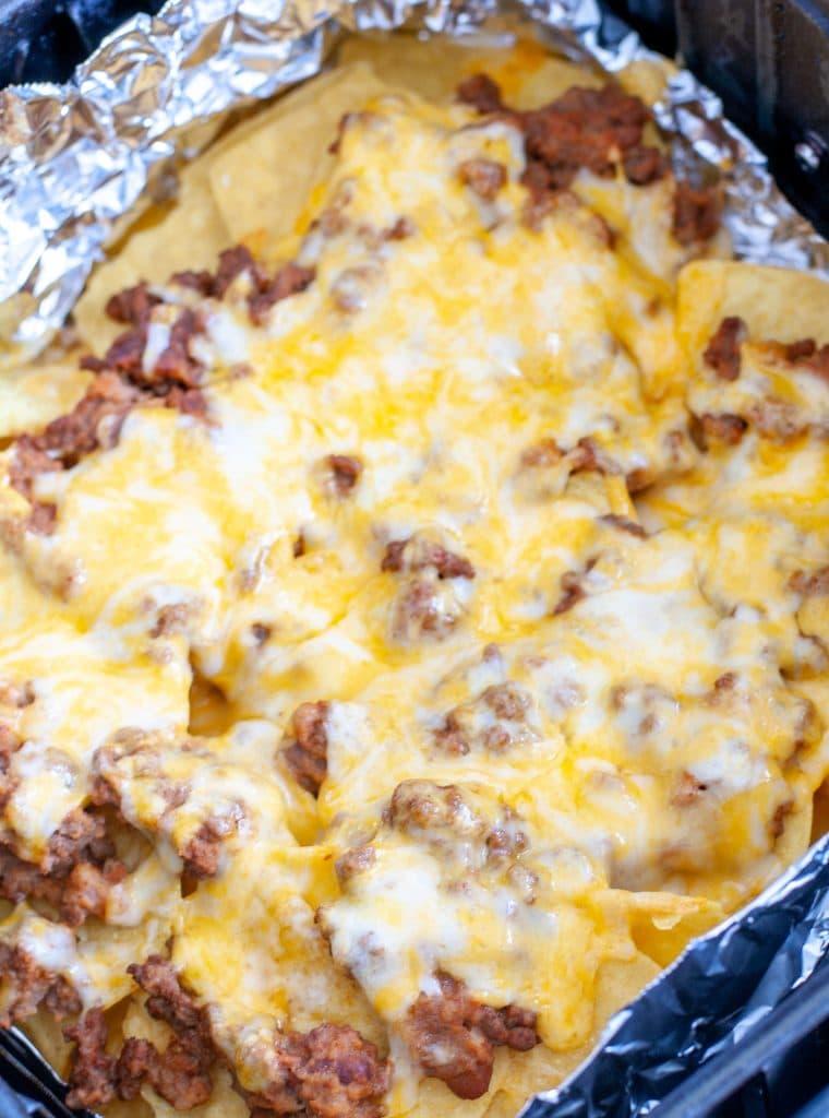 Beef nachos in air fryer basket.