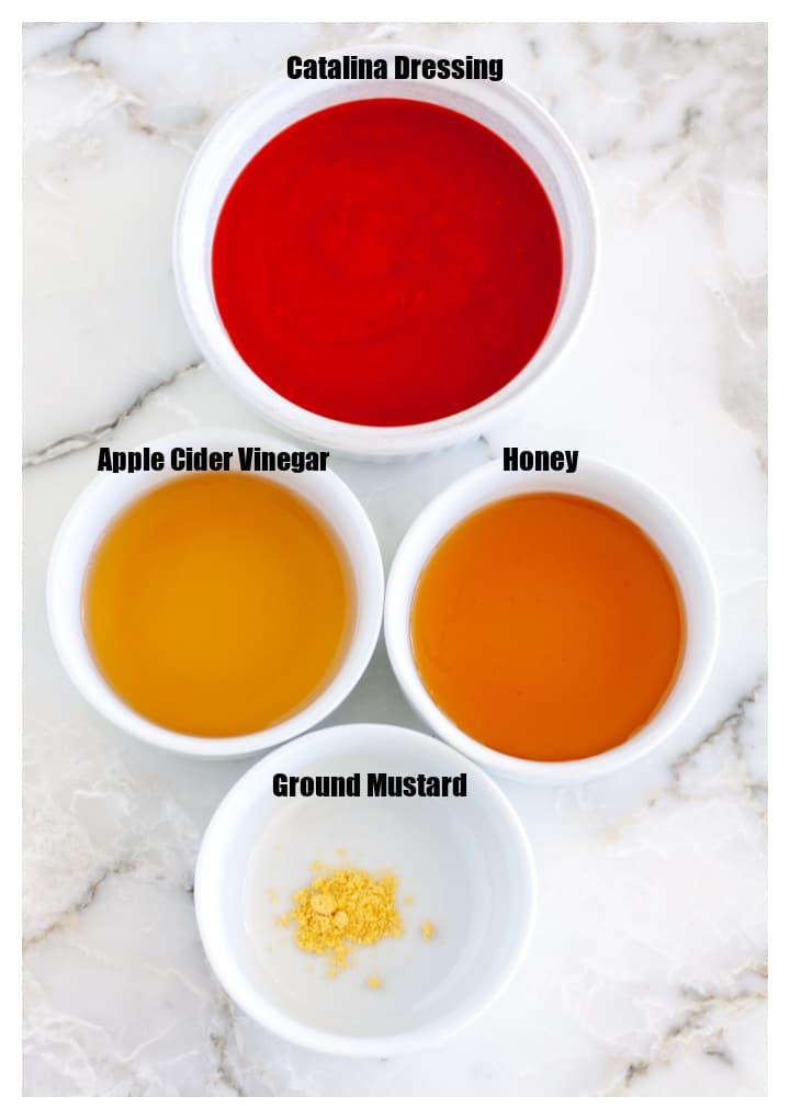 Bowl of catalina dressing, honey, vinegar, mustard.
