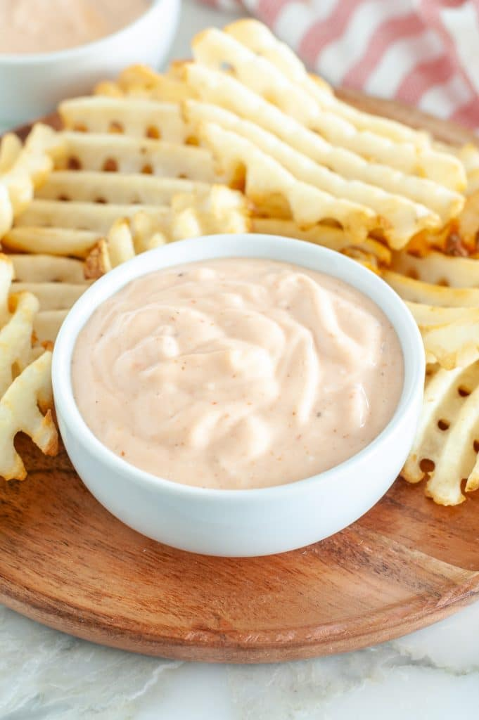 Bowl of fry sauce with waffle fries.