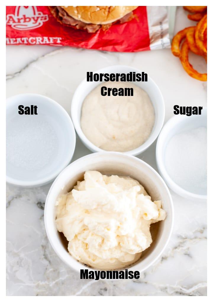 Bowl of mayo, salt, sugar and horseradish.