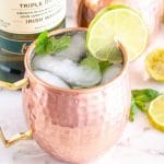 Copper cup with a lime slice.